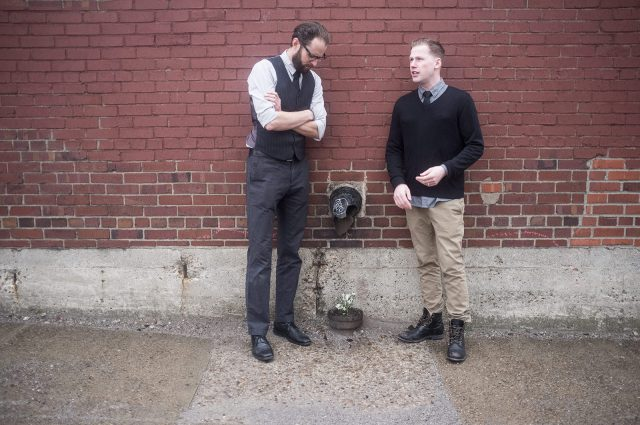 📷️ The boys musing about life and death in front of a brick wall and a flower growing out of a pipe. Jerome proving definitively you should never wear a shirt with pockets under a sweater. (Photo by William Lardinois)